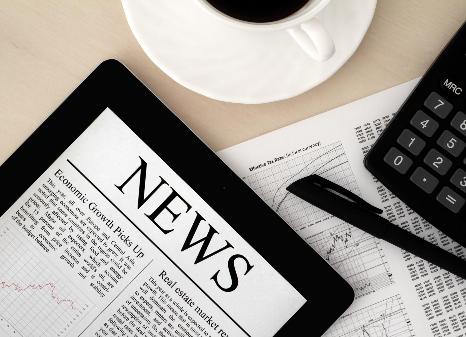 newspaper_on_tablet